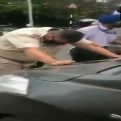 Shocking: Amid lockdown, man drags police officer on car's bonnet in Punjab's Jalandhar