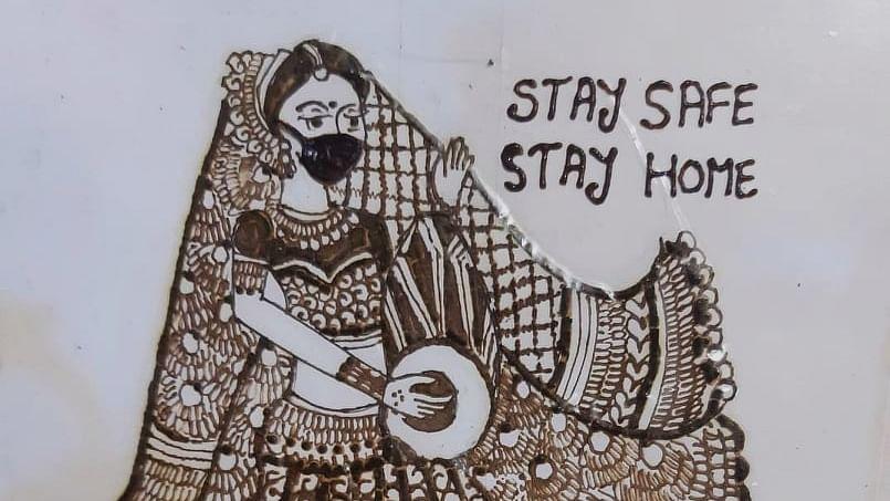 Aishwarya's mehndi art giving message of stay at home.