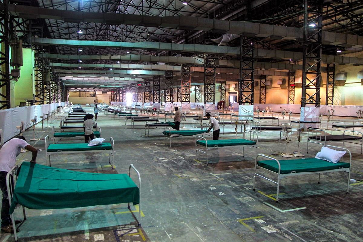 Hospital beds are being set up at a quarantine centre in Mumbai