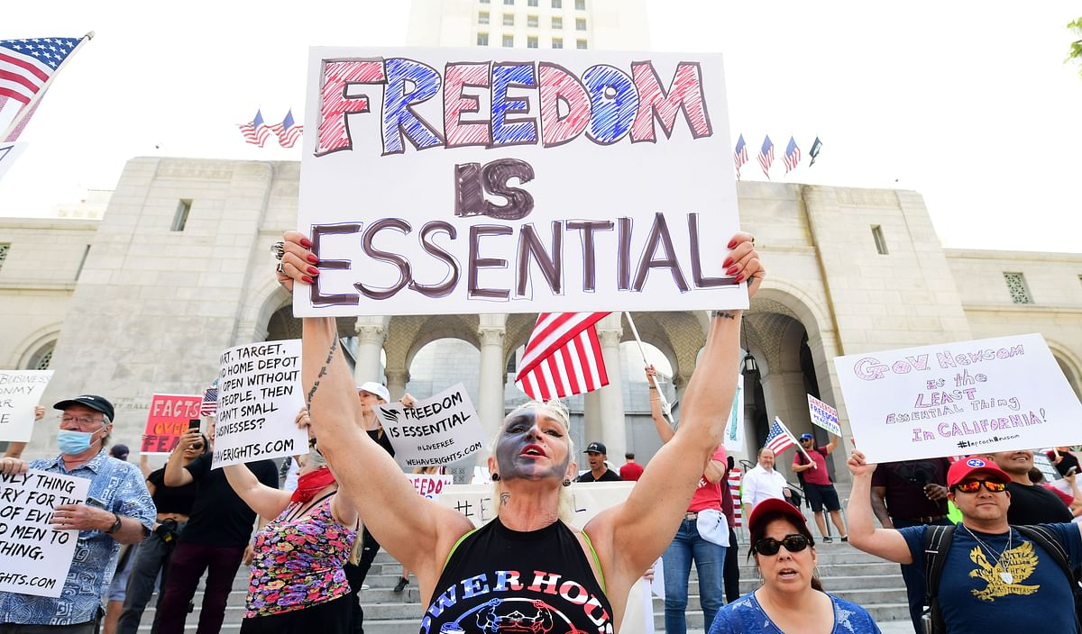 Demonstrators rally in front of Los Angeles City Hall to demand the end to the states shutdown due to the coronavirus pandemic.