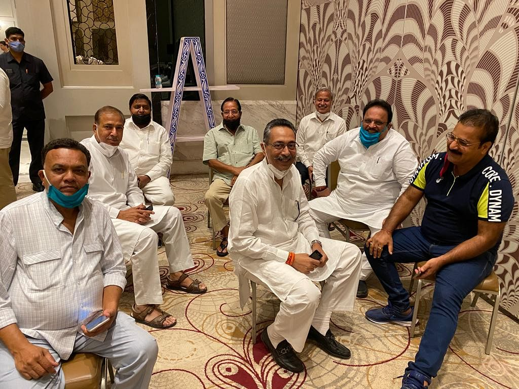 In pics: Rajasthan Congress MLAs holed up in luxury resort break social distancing norms, take off masks