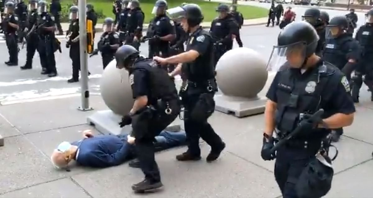 A 75-year-old protester falls to the ground after being shoved by Buffalo, New York, police, on June 4, 2020, after Buffalos curfew went into effect, according to media reports.