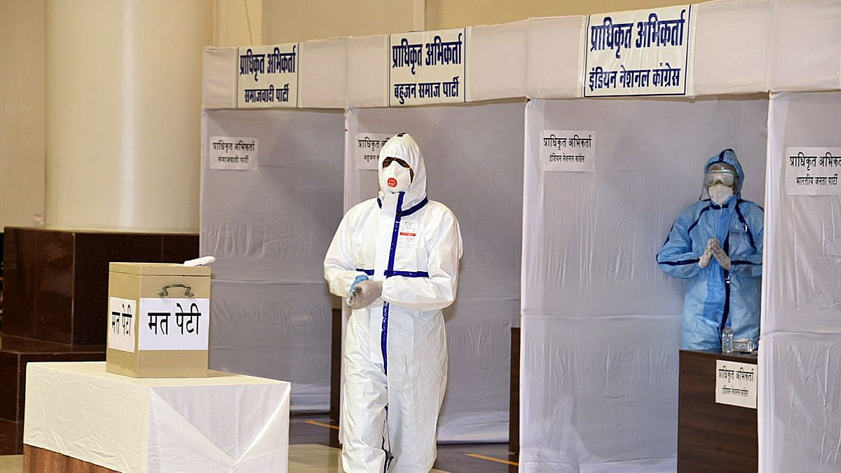 COVID19-positive Congress MLA from Kalapeepal, Kunal Choudhary wearing PPE kit arrives to cast his vote for Rajya Sabha election in the State Assembly during coronavirus lockdown, in Bhopal/ File pIc