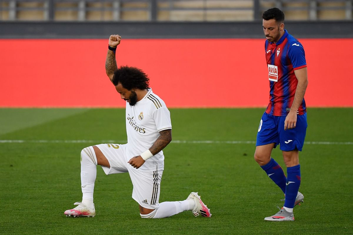 Real Madrid's Brazilian defender Marcelo kneels on the field to celebrate his goal