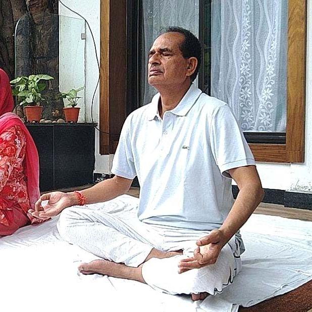 International Yoga Day 2020: MP CM Shivraj Singh Chouhan performs yoga with wife, sons