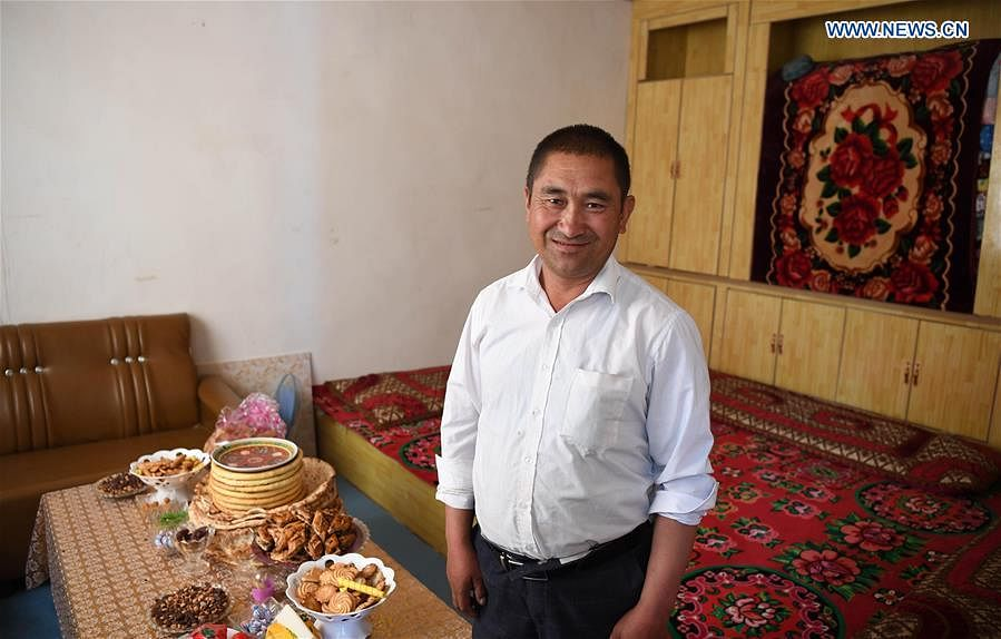 Across China: Villagers relish modern life in new houses in Xinjiang