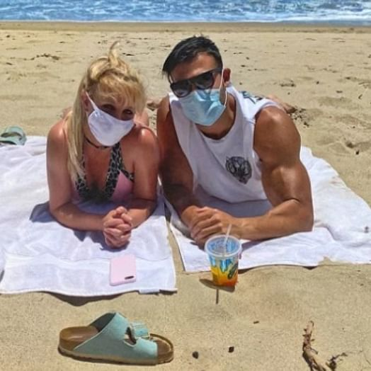 Britney Spears goes on a beach date with boyfriend Sam Asghari in a mask and bikini
