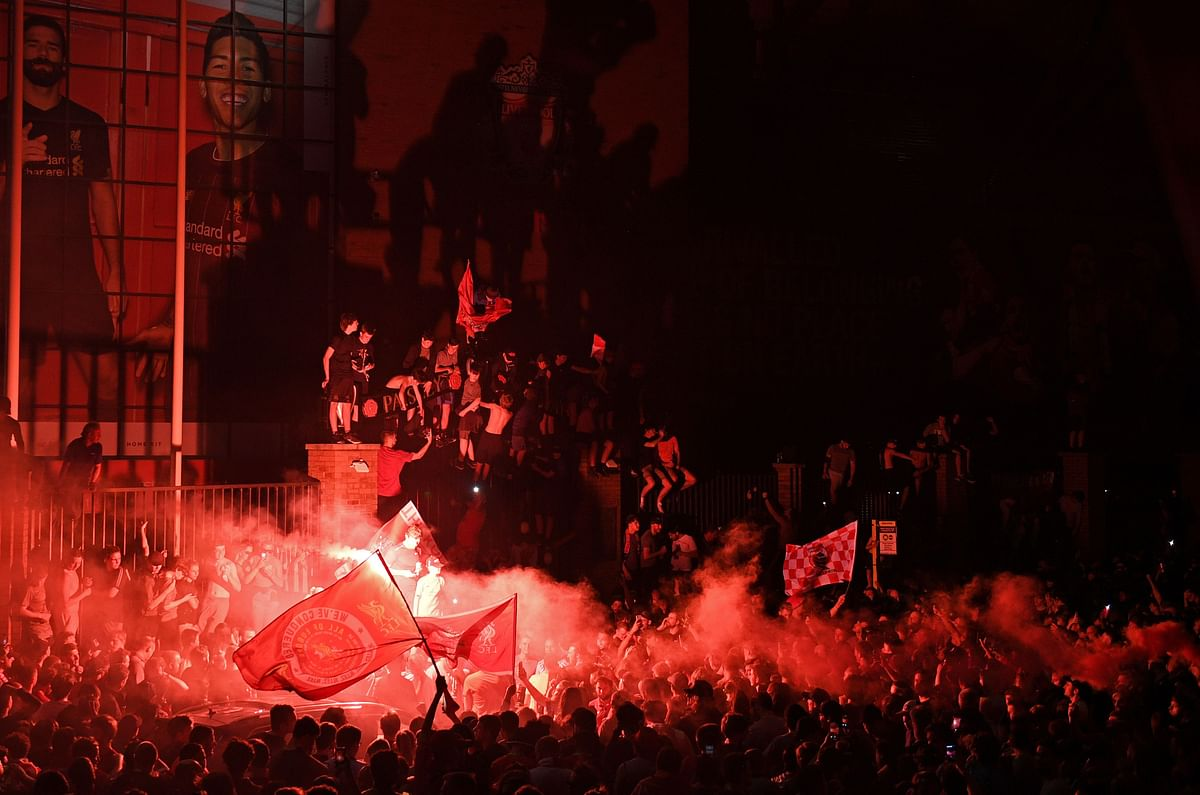 What pandemic? Liverpool fans defy social distancing norms to celebrate the Reds victory after 30-year dry spell
