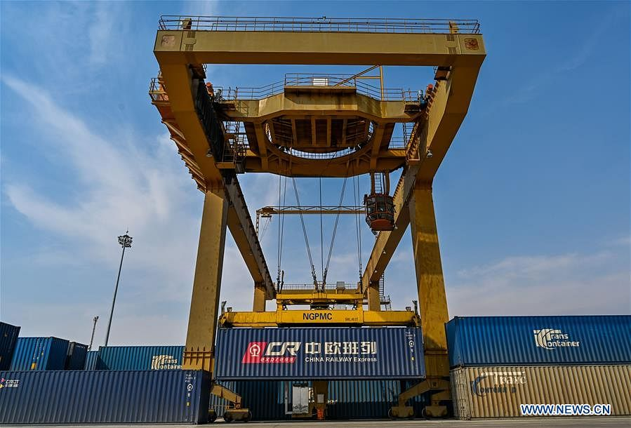 A crane loads containers at the Manzhouli Railway Station in Manzhouli, north China's Inner Mongolia Autonomous Region, April 13, 2020. Initiated in 2011, the China-Europe rail transport service is considered a significant part of the Belt and Road Initiative to boost trade between China and countries participating in the program. Amid the coronavirus pandemic, the service remained a reliable transportation channel as air, sea and road transportation have been severely affected. The freight trains have also been playing a crucial role in helping with the fight against the pandemic in Europe, sending massive quantities of medical supplies such as face masks and goggles.