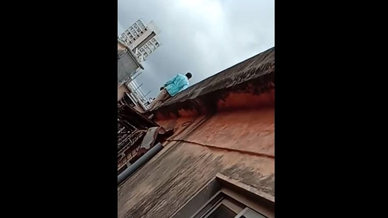 Mumbai fire department rescues mentally unstable person who threatened to jump off a three storey building in Dadar