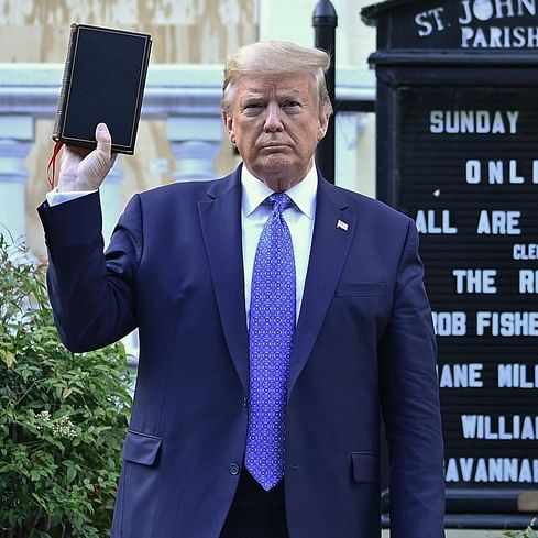 'He's holding the Bible upside down': Trump called out for church photo op amid George Floyd protests