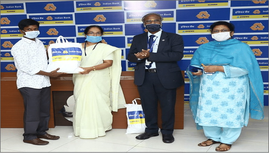 Indian Bank distributes essential commodities to the tribal people in Tiruvallur District