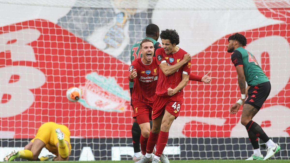 Liverpool's Jordan Henderson celebrates with Curtis Jones