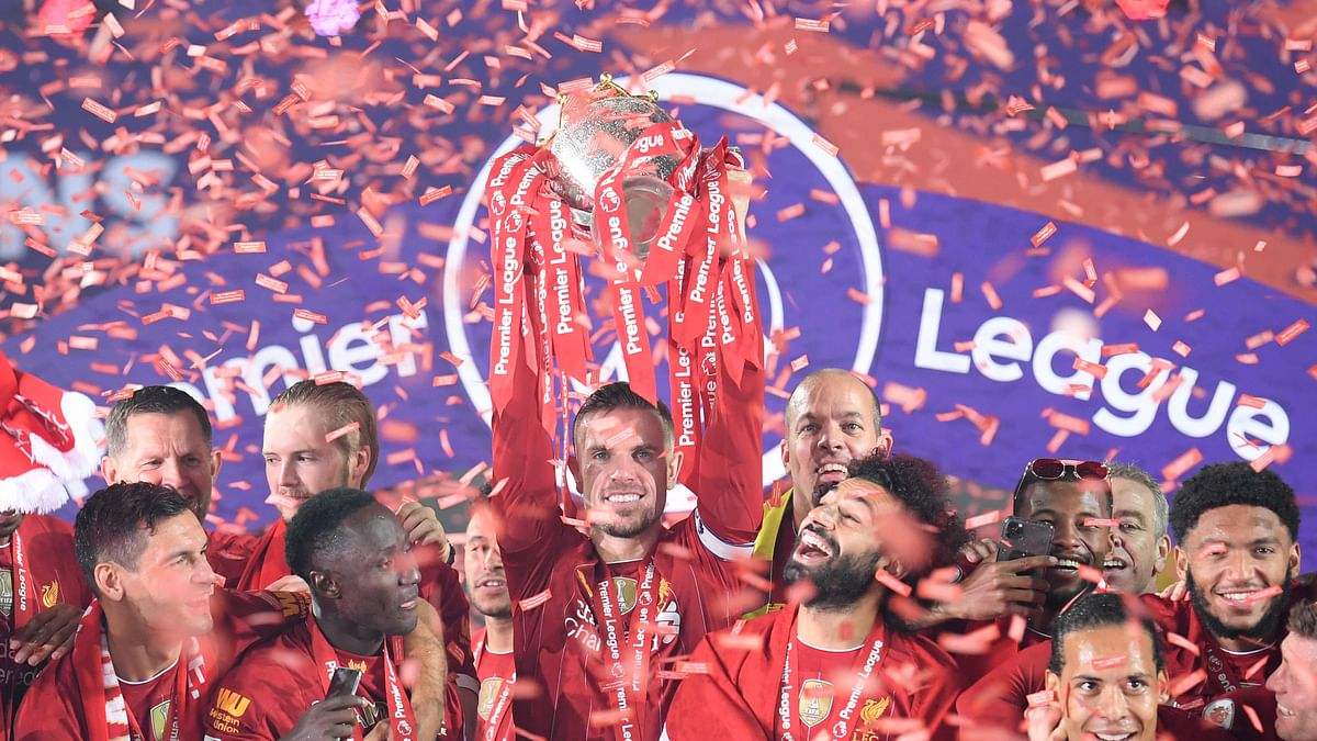Painting it red: Liverpool lift Premier League title after 30-year wait