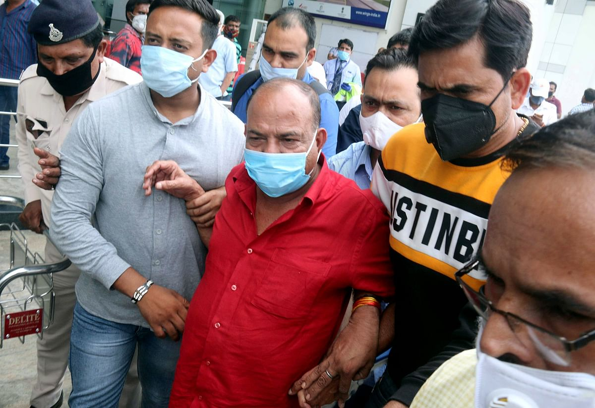 Key accused of running a sex racket and raping minor girls, city-based A Hindi newspaper owner, Pyare Mian (red dress) brought to Bhopal by the police on Thursday, after he was arrested in Srinagar yesterday/ Representative Pic