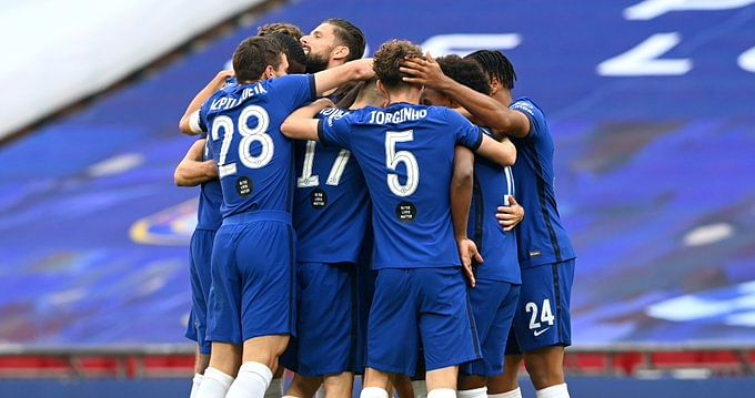 Chelsea players celebrate their victory over Manchester United