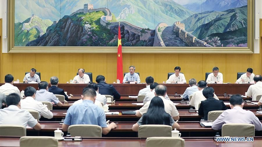 Chinese Vice Premier Hu Chunhua, also a member of the Political Bureau of the Communist Party of China Central Committee, attends a teleconference on stabilizing foreign trade and investment, in Beijing, capital of China, July 9, 2020