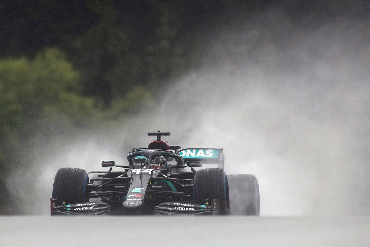 Hamilton takes pole; World champion proves he is the best driver in wet conditions