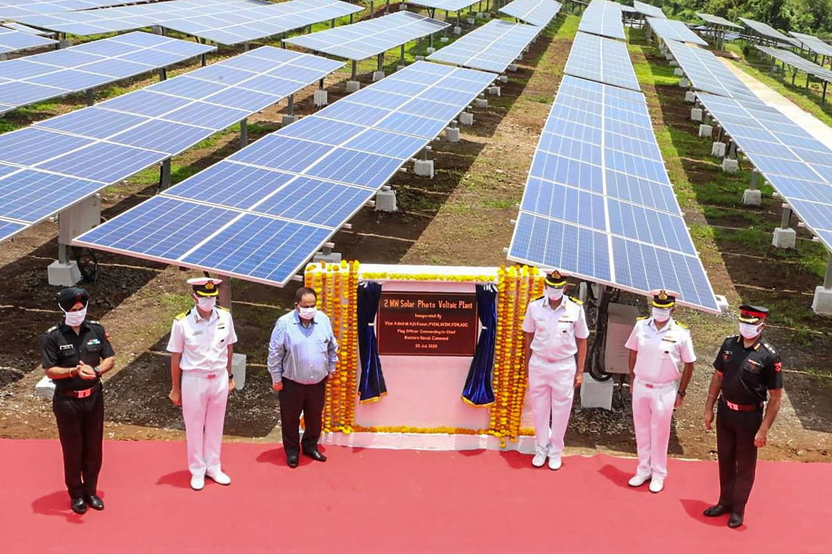 View of 2 MW Solar Power Plant at Naval Station Karanja along with the dignitaries involved in the project, during its inauguration, at Uran in Navi Mumbai on Tuesday.