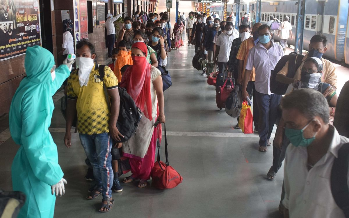 Migrant workers undergo thermal screening at Dadar on Friday.