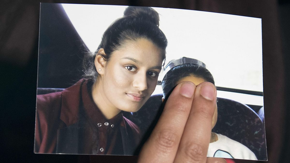In this file photo taken on February 22, 2015 Renu, eldest sister of missing British girl Shamima Begum, holds a picture of her sister while being interviewed by the media in central London, on February 22, 2015. - Shamima Begum, who had her UK citizenship revoked after travelling to Syria to join the Islamist State group, should be allowed to return to the country to challenge the ruling, a court ruled on July 16, 2020.