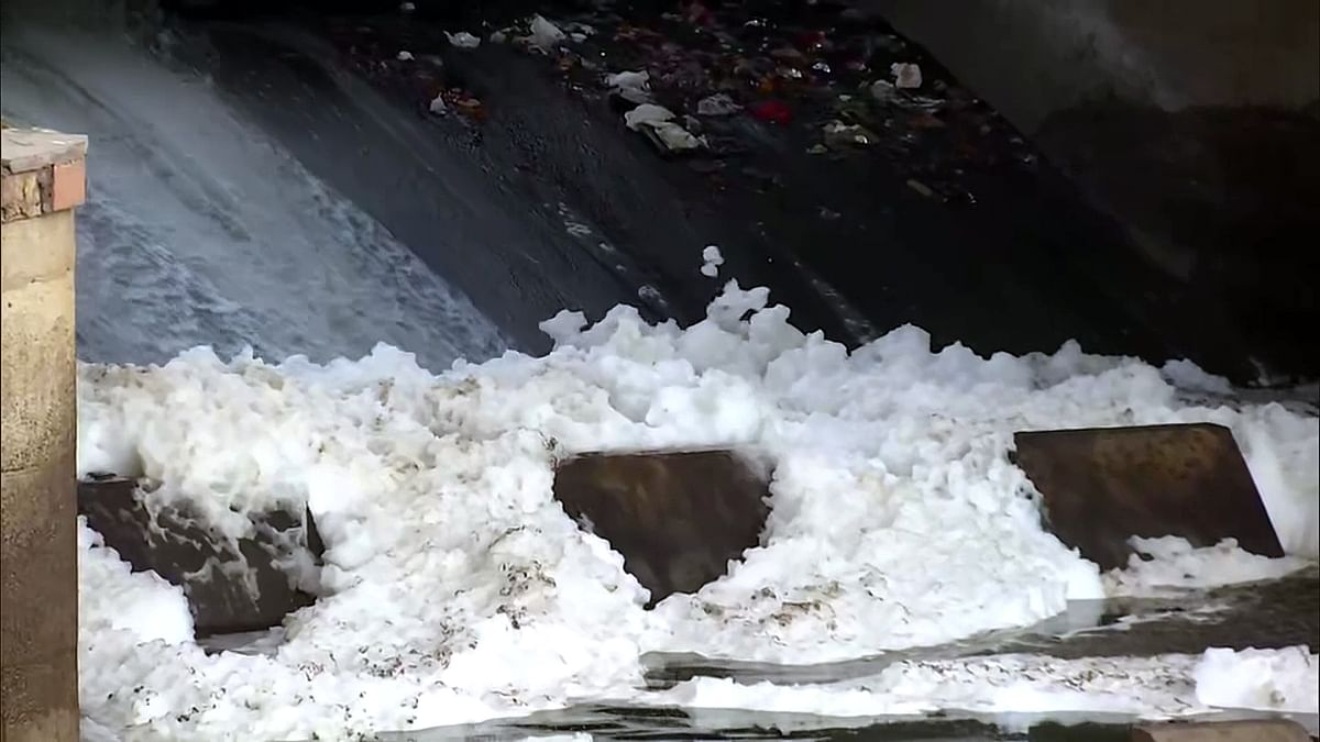 In Pictures: As lockdown ends, toxic foam seen in Yamuna river at Delhi