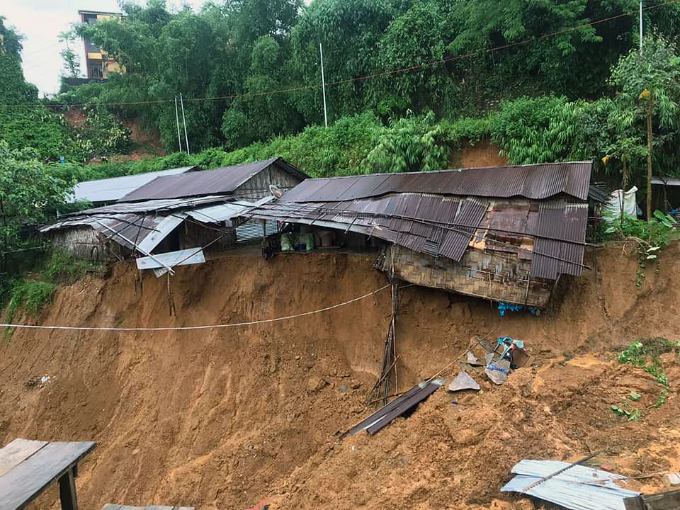 Houses damaged after a massive landslide due to incessant rainfall, in Itanagar on Thursday.