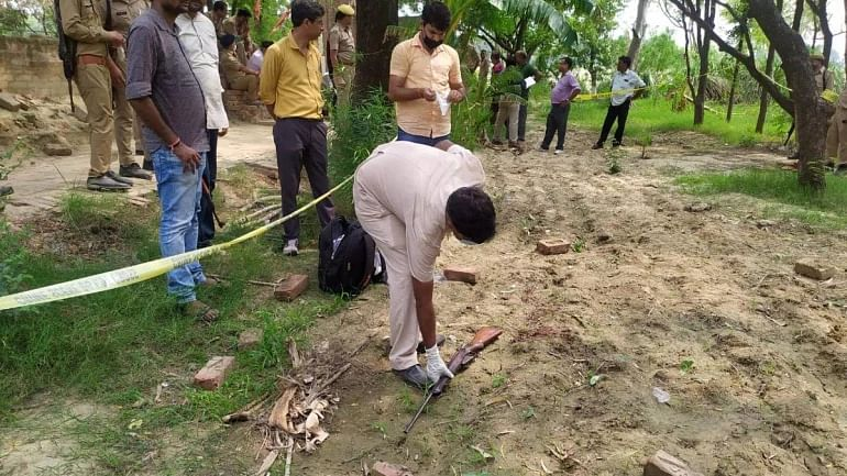 Investigators examine the Kanpur encounter site.