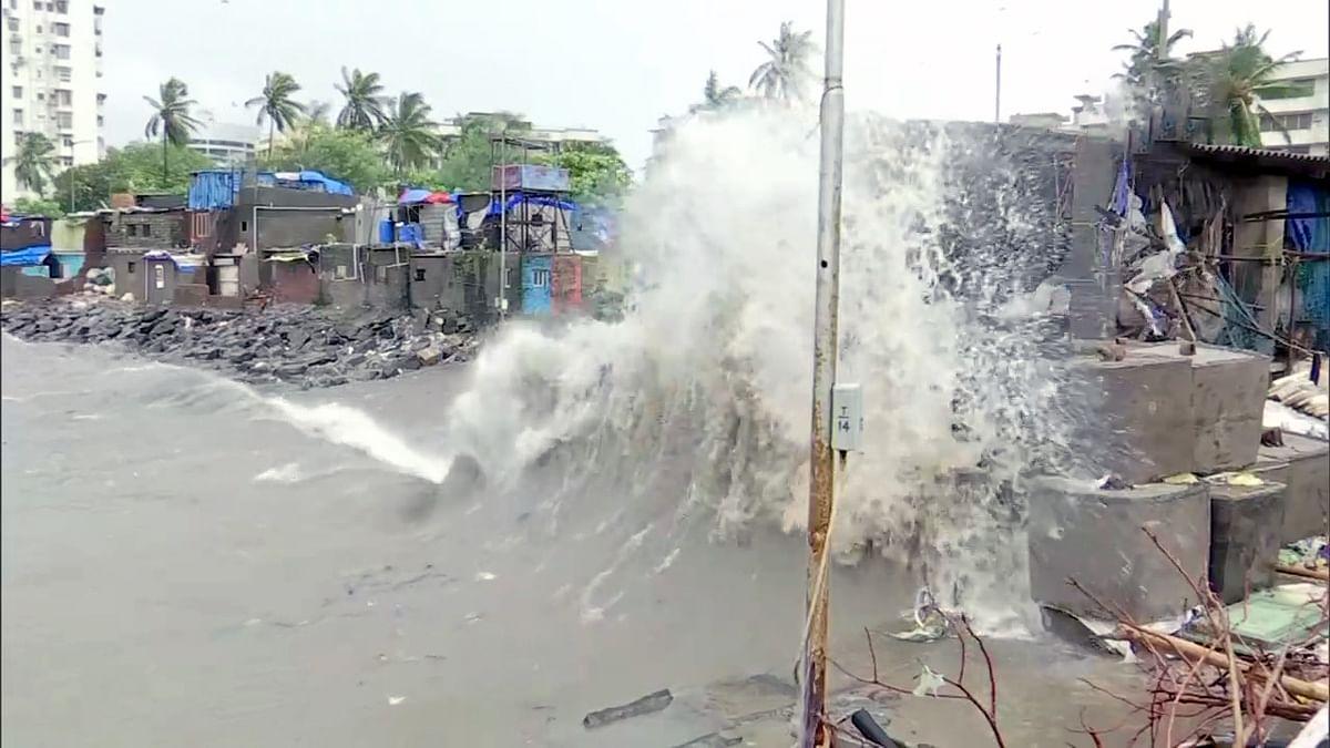 Waves crash ashore during high tide, at Colaba in Mumbai on Sunday