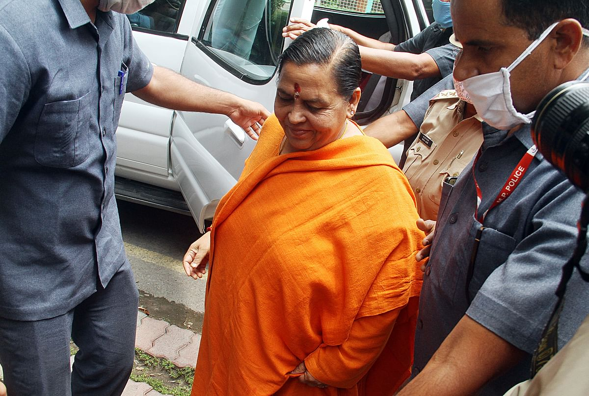 BJP leader Uma Bharti arrived at CBI special court to record her statement in connection with the Babri Masjid demolition case, in Lucknow on Thursday.