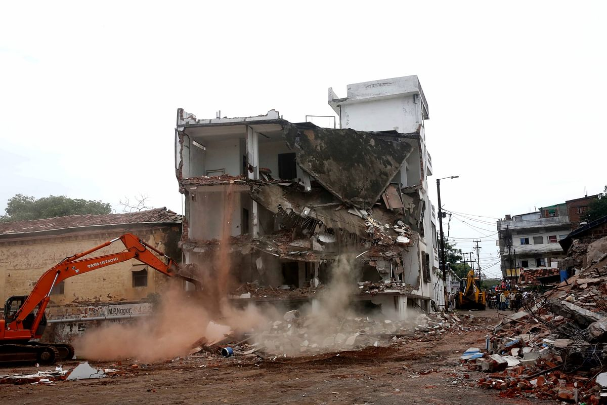 BMC workers demolished illegal construction of a newspaper owner of a Hindi daily after unearthed a sex racket, in Bhopal on Tuesday. (File Photo)