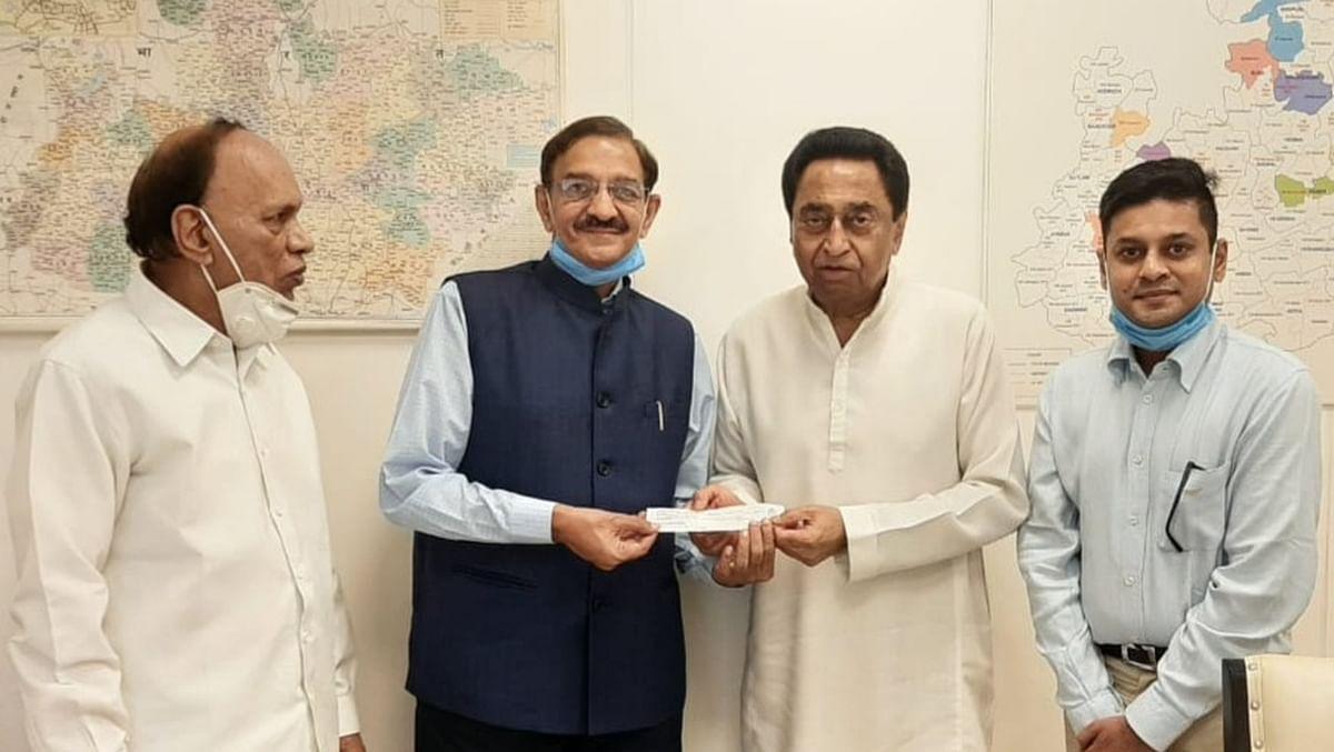 City businessman Ajay Chordia with MP Congress chief Kamal Nath at Bhopal on Thursday.