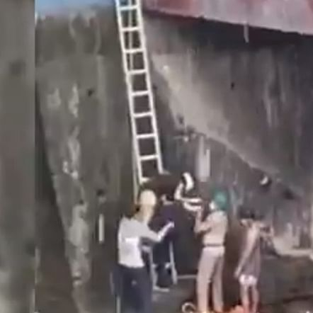 Mumbai fire brigade officials rescue 21-year-old woman who fell into Dahisar river