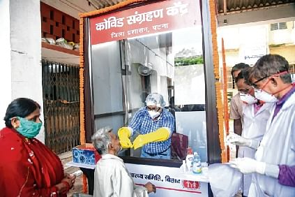 A man gives a swab sample for Covid-19 test at a collection centre during a total lockdown, in Patna on Tuesday.