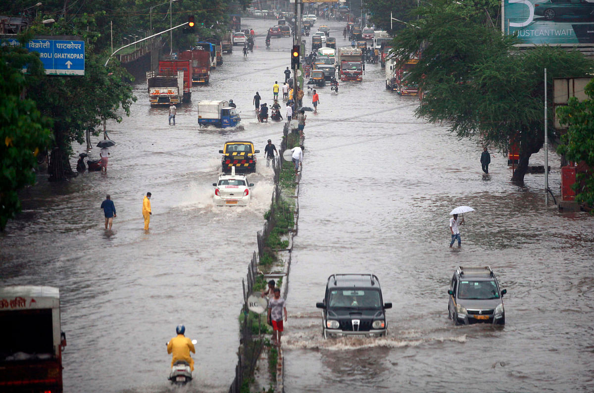 Vehicles ply through water logged LBS roads after heavy rainfall, in Mumbai on Sunday.