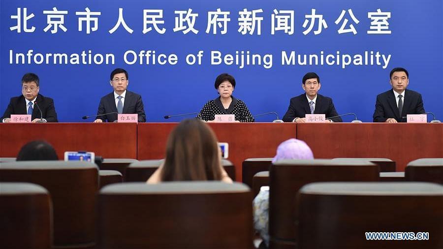 Beijing to lower COVID-19 emergency response