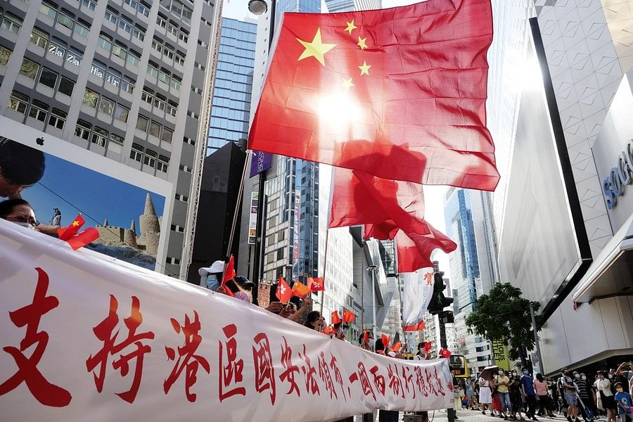 Hong Kong citizens celebrate the passage of the Law of the People's Republic of China on Safeguarding National Security in the Hong Kong Special Administrative Region (HKSAR) in Causeway Bay of south China's Hong Kong, June 30, 2020