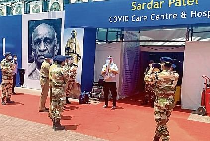 The first cured patient is discharged from Sardar Patel Covid care and hospital at Radha Soami Satsang Beas centre, in Chhattarpur, New Delhi on Monday.