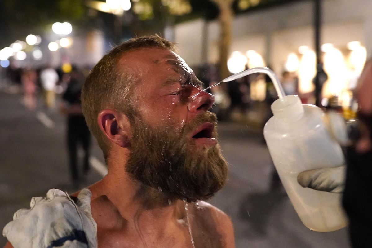 Medics take care of a protester who was tear-gassed by federal officers in Portland.