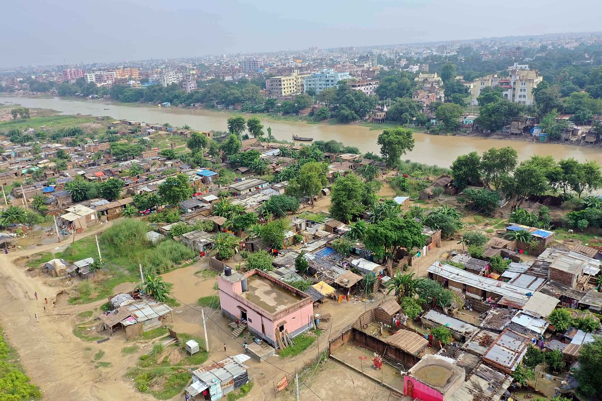 An aerial view of flooded Bind Toli area along the banks of River Ganga following heavy rain, in Patna on Saturday.