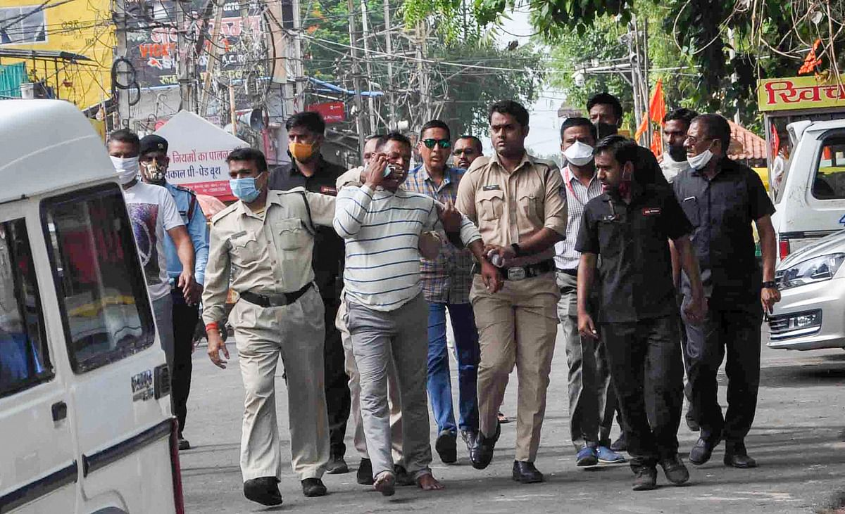 Gangster Vikas Dubey apprehended by police personnel after a nearly week-long manhunt