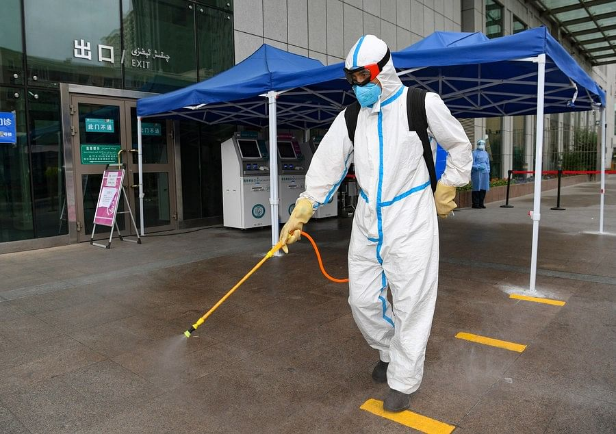 A staff member conducts disinfection at a hospital in Urumqi, northwest China's Xinjiang Uygur Autonomous Region, July 21, 2020. (Xinhua/Song Yanhua)