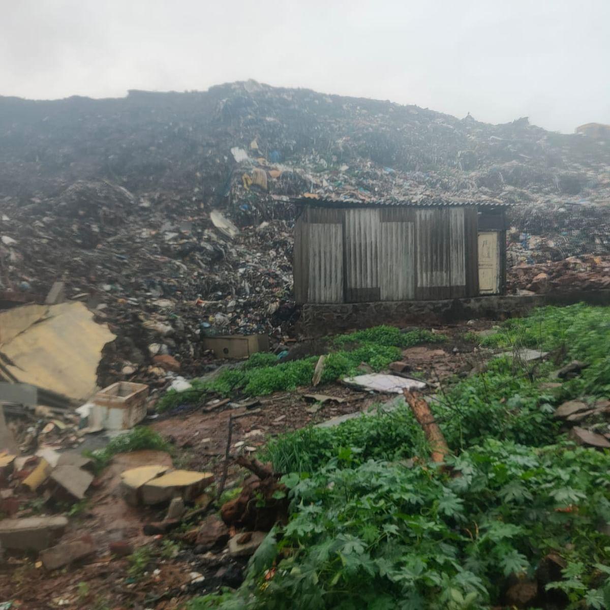 Garbage mountain crashes on hutments near Uttan Dump Yard.