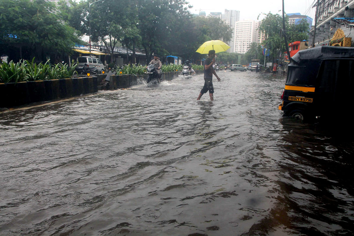 A view of the waterlogged road following heavy rainfall at S.V Road, Jogeshwari in Mumbai on Sunday.