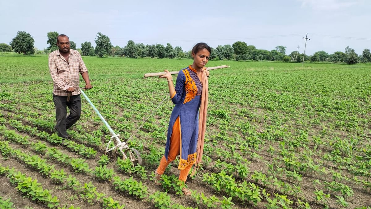 Radha Kumari Dhakkadploughing the field with her father Jagdish Dhakkad.