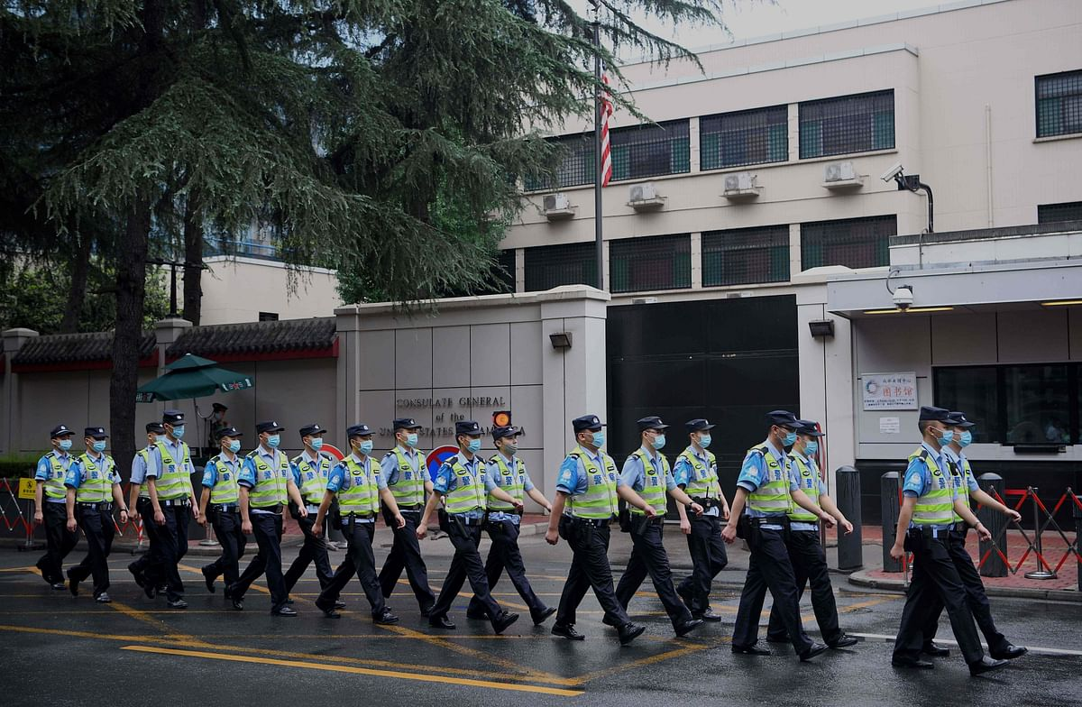 Policemen march past the US consulate in Chengdu.