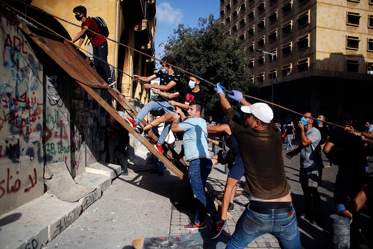 Beirut: Demonstrators clash with police during a protest against the political elites and the government after this weeks deadly explosion at Beirut port which devastated large parts of the capital in Beirut, Lebanon, Saturday, Aug. 8, 2020