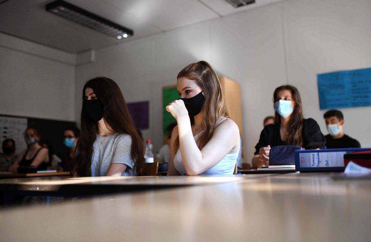 Coronavirus reawakens in US schools, colleges