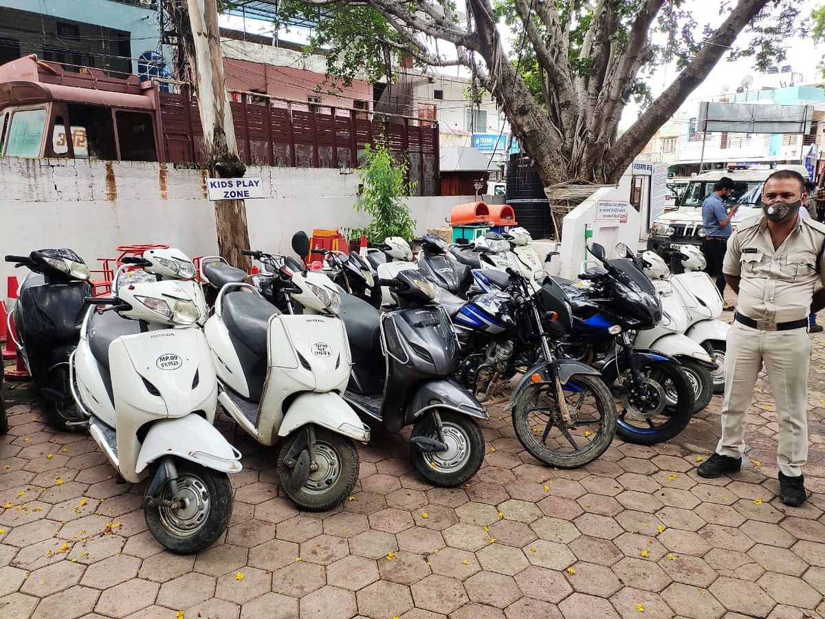 Hiranagar police personnel with the seized vehicles.