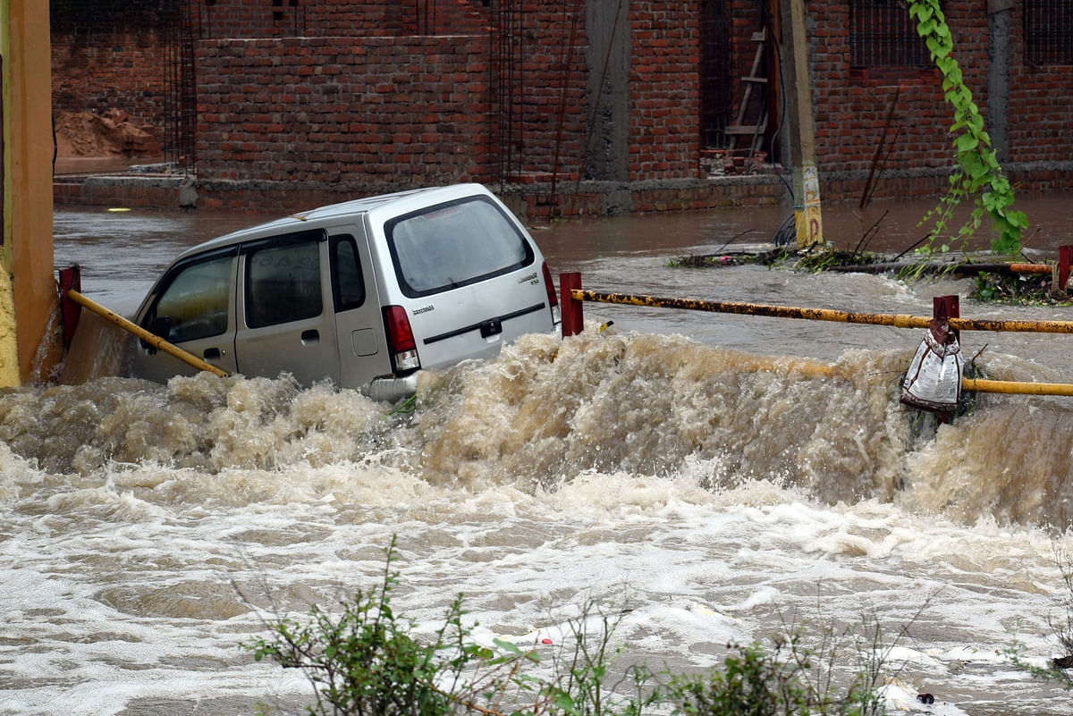 Car submerged in a flooded street in Satna, MP, on Thursday.